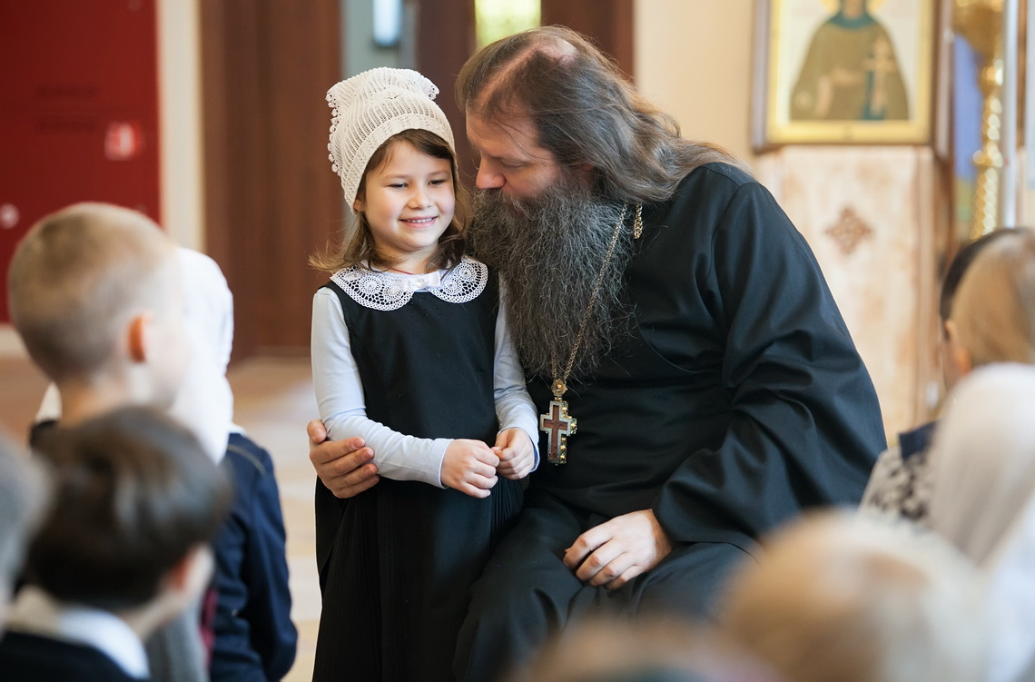 conversation between priest and a child