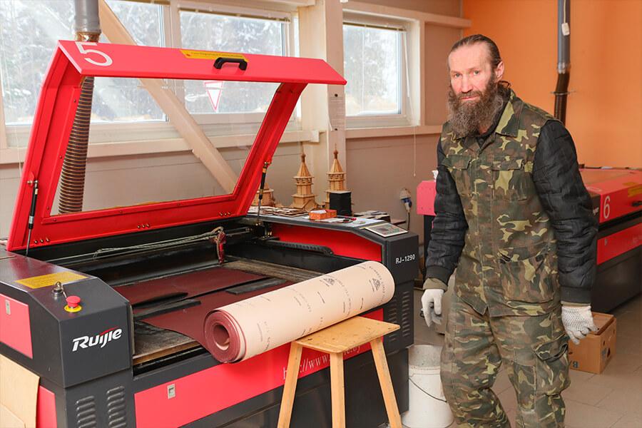 a worker of laser engraving workshop